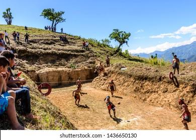 San Andres Semetabaj, Lake Atitlan, Guatemala - November 10, 2018:  Local indigenous Maya men play Maya ballgame in ballgame court as spectators watch at Lake Atitlan in Guatemalan highlands.