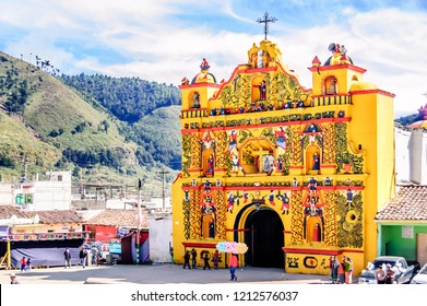 San Andres Xecul, Totonicapan, Guatemala -  October 30, 2011: Intricate yellow facade of catholic church of San Andres Xecul in department of Totonicapan in western highlands of Guatemala.