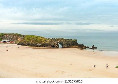 San Antolin beach, Asturias, Spain. Rainy summer day in the Cantabrian sea.
