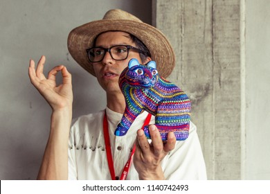 San Antonio Arrazola, Oaxaca / Mexico - 21/7/2018:  (Tourist guide explaining about traditional alebrijes handcrafts, made by the indigenous people of San  Antonio Arrazola Oaxaca Mexico)