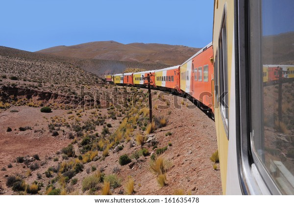 "SAN ANTONIO DE LOS COBRES REGION, ARGENTINA - APRIL 27: So called ""Tren a las nubes (Train to the clouds)"" goes from Salta to La Polvorilla viaduct on April 27, 2013, Argentina."