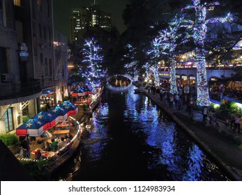 San Antonio River Walk and the river boat at night