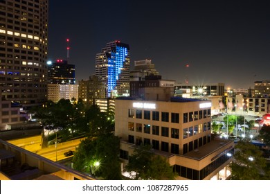 San Antonio, Texas - April 17, 2018: San Antonio city skyline at night shot from the balcony of the Embassy Suites downtown.