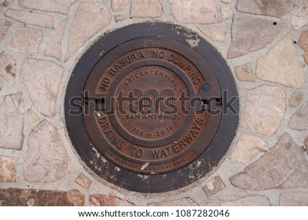 San Antonio, Texas - April 18, 2018: San Antonio tricentennial year with the 300 logo on manhole covers.