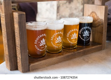 San Antonio, Texas - April 19, 2018: Craft beer sampler featuring four 8oz beers from Southerleigh Brewery.