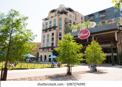 San Antonio, Texas - April 19, 2018: Plaza at the Historic Pearl, an old industrial area that has been converted into a multi use space with condos, restaurants, breweries and more.