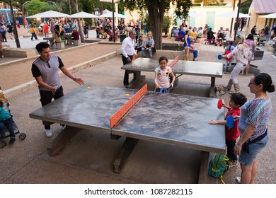 San Antonio, Texas - April 19, 2018: People play ping pong at Hemisfair Park during the opening night celebration of Fiesta San Antonio during the city's tricentennial year.