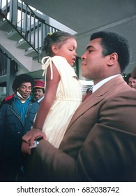 SAN ANTONIO, TEXAS - MARCH 10, 1979: Muhammad Ali holds a young fan in his arms during the signing of autographs at the San Antonio International Airport.