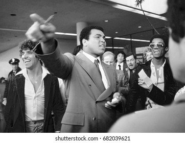 SAN ANTONIO, TEXAS - MARCH 10, 1979: Muhammad Ali entertains fans while signing autographs at the San Antonio International Airport.