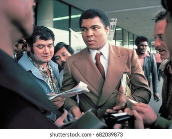 SAN ANTONIO, TEXAS -  MARCH 10, 1979: Muhammad Ali signs autographs for fans at the San Antonio International Airport.