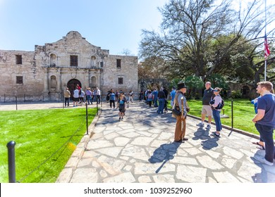 SAN ANTONIO, TEXAS - MARCH 2, 2018 - People get in line to visit the historical Alamo Mission, built in 1718 and site of the famous 1836 Battle of the Alamo