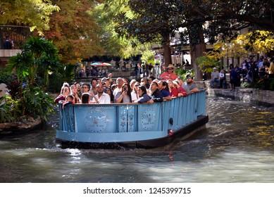 SAN Antonio, TEXAS - November 23: Tourists   enjoying the San Antonio Riverwalk Boat Ride, in   San Antonio TX, on November 23, 2018