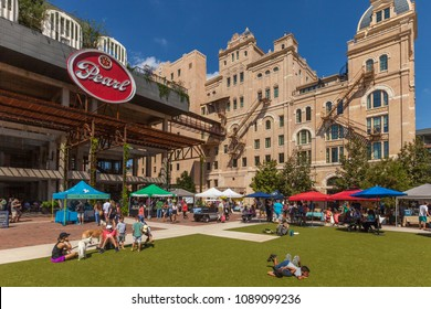 SAN ANTONIO, TEXAS - OCTOBER 7, 2017 - People walking and shopping at the Farmers Market at The Pearl Brewery.