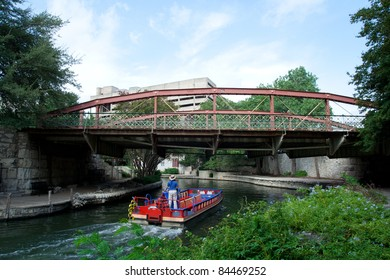 SAN ANTONIO, TX - AUG 12: A River Taxi at the River Walk in San Antonio, Texas on August 12, 2011. The River Walk is 5 miles along the San Antonio River and has over 20 yearly events.