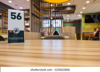 SAN ANTONIO, TX, USA - NOVEMBER 9, 2018 -  Ordering number on table at a McDonald's restaurant. Waiting for order in McDonald's restaurant.