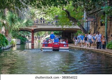 San Antonio, TX/USA - circa November 2015: Tourists and Boats at River Walk in San Antonio, Texas