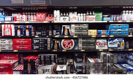 SAN ANTONIO, US - JUL 19, 2016: Various bottles of craft, microbrews, IPAs, domestic and imported beer beers from around the world on shelf display in supermarket. Alcohol background, different beers.
