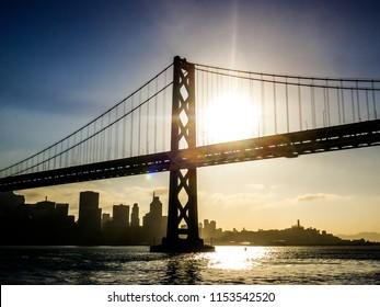 San Francisco–Oakland Bay Bridge (Bay Bridge) with skyline of San Francisco at sunset, California, USA