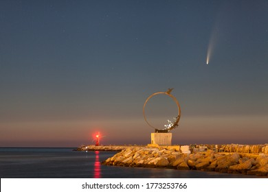 San Benedetto del Tronto, Italy. July, 9, 2020: C/2020 F3 Neowise comet over the pier of San Benedetto del Tronto , a touristic city on the Adriatic coast