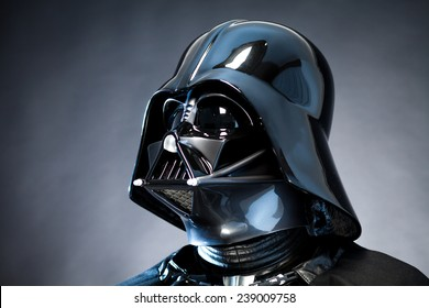 SAN BENEDETTO DEL TRONTO, ITALY. DECEMBER 5, 2014. Close up portrait of Helmet replica of the costume of Darth Vader ( Lord Fener). Studio portrait with grazing blue light and black background