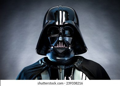 SAN BENEDETTO DEL TRONTO, ITALY. DECEMBER 5, 2014. Helmet of Darth Vader costume replica. Lord Fener is a fictional character of Star Wars saga. Black background with grazing blue light