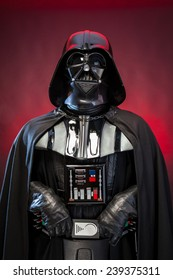 SAN BENEDETTO DEL TRONTO, ITALY. DECEMBER 5, 2014. Half-lenght portrait of  Darth Vader costume replica . Darth Vader or Dart Fener is a fictional character of Star Wars saga. Red background