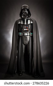 SAN BENEDETTO DEL TRONTO, ITALY. DECEMBER 5, 2014.Studio portrait of Dart Vader costume replica . Darth Vader or Dart Fener is a fictional character of Star Wars saga. Black background