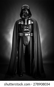 SAN BENEDETTO DEL TRONTO, ITALY. DECEMBER 5, 2014. Studio portrait of Darth Vader costume replica . Lord Fener is a fictional character of Star Wars saga. Black background. Black and white picture