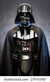SAN BENEDETTO DEL TRONTO, ITALY. MAY 16, 2015. Half-lenght portrait of Darth Vader. Darth Vader is a fictional character of Star Wars saga. Black background. Blue grazing light