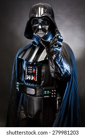 SAN BENEDETTO DEL TRONTO, ITALY. MAY 16, 2015. Portrait of Darth Vader costume replica with grab hand . Darth Vader is a fictional character of Star Wars saga.  Blue grazing light