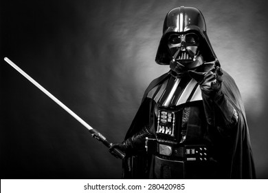 SAN BENEDETTO DEL TRONTO, ITALY. MAY 16, 2015. Portrait of Darth Vader costume replica with grab hand and his sword . Lord Fener is a fictional character of Star Wars saga.  Black and white picture