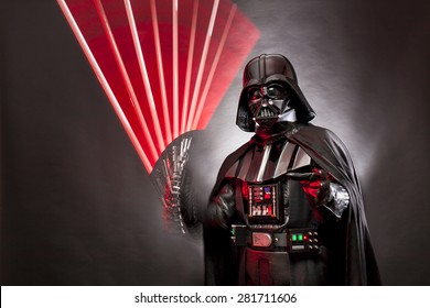 SAN BENEDETTO DEL TRONTO, ITALY. MAY 16, 2015. Stroboscopic photography of Darth Vader costume replica with grab hand and his sword .Studio photo,   Black background