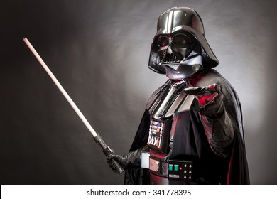 SAN BENEDETTO DEL TRONTO, ITALY. MAY 16, 2015. Portrait of Darth Vader costume replica with grab hand and  sword . Darth Vader is a fictional character of Star Wars saga.  Red grazing light