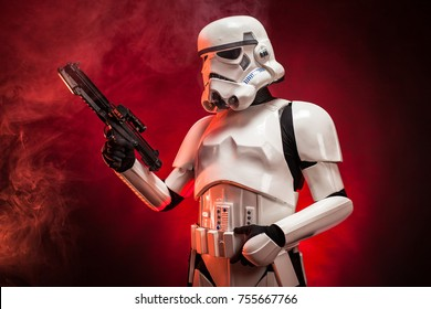 SAN BENEDETTO DEL TRONTO, ITALY. NOVEMBER 11, 2017. Studio portrait  of stormtrooper costume replica,  a fictional character of Star Wars saga. Red and black background with smoke