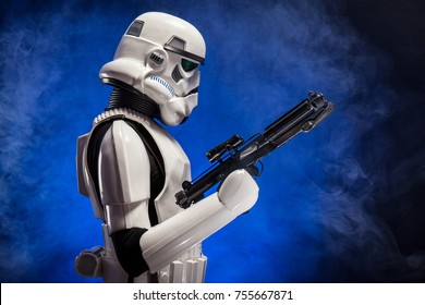 SAN BENEDETTO DEL TRONTO, ITALY. NOVEMBER 11, 2017. Studio portrait  of stormtrooper costume replica,  a fictional character of Star Wars saga. Blue and black background with smoke