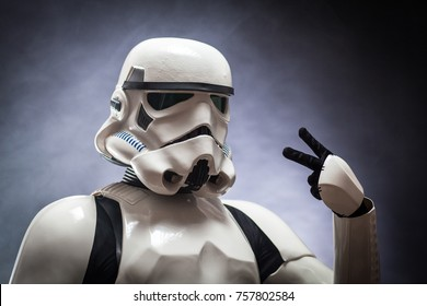 SAN BENEDETTO DEL TRONTO, ITALY. NOVEMBER 11, 2017. Close up studio portrait  of stormtrooper costume replica, with V sign hand. He is a fictional character of Star Wars saga.