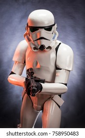 SAN BENEDETTO DEL TRONTO, ITALY. NOVEMBER 11, 2017. Studio portrait  of stormtrooper costume replica, with blaster E-11 gun. He is a fictional character of Star Wars saga. Red reflexes