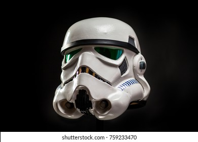 SAN BENEDETTO DEL TRONTO, ITALY. NOVEMBER 11, 2017. Profile studio portrait  of stormtrooper costume replica helmet. He is a fictional character of Star Wars saga. Black background