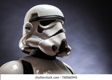 SAN BENEDETTO DEL TRONTO, ITALY. NOVEMBER 11, 2017. Close up studio portrait  of stormtrooper costume replica, with blaster E-11 gun. He is a fictional character of Star Wars saga. Black background