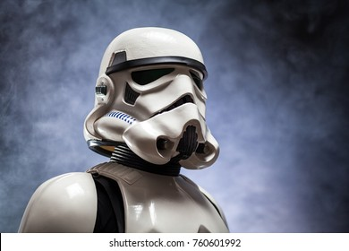 SAN BENEDETTO DEL TRONTO, ITALY. NOVEMBER 11, 2017. Close up studio portrait  of stormtrooper costume replica,  He is a fictional character of Star Wars saga. Black background with smoke