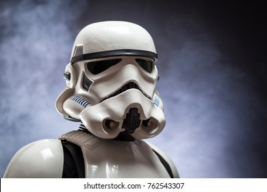 SAN BENEDETTO DEL TRONTO, ITALY. NOVEMBER 11, 2017. Close up studio portrait  of stormtrooper costume replica. He is a fictional character of Star Wars saga. Black background with smoke