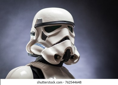 SAN BENEDETTO DEL TRONTO, ITALY. NOVEMBER 11, 2017. Close up studio portrait  of stormtrooper costume replica, with . He is a fictional character of Star Wars saga. Black background with smoke