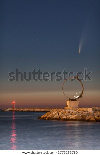 San Benedetto del Tronto, Italy. July, 9, 2020: C/2020 F3 Neowise comet over the pier of San Benedetto del Tronto , a touristic city on the Adriatic coast