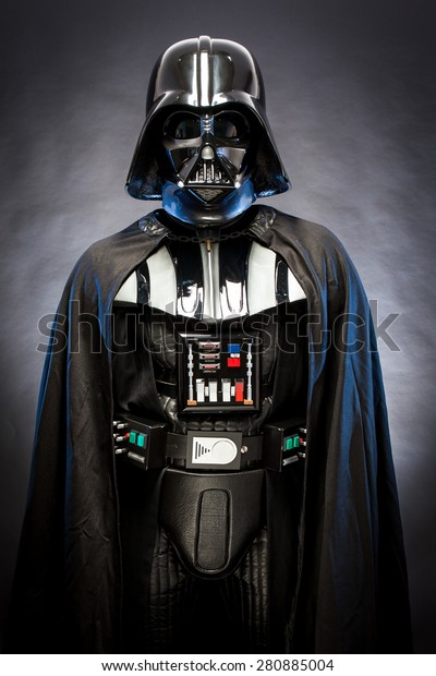 SAN BENEDETTO DEL TRONTO, ITALY. MAY 16, 2015. Portrait of Darth Vader costume replica . Darth Vader is a fictional character of Star Wars saga.  Blue grazing light, black background