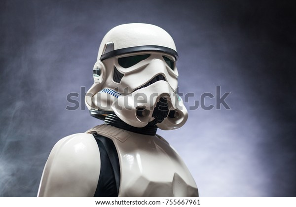SAN BENEDETTO DEL TRONTO, ITALY. NOVEMBER 11, 2017. Studio portrait  of stormtrooper costume replica,  a fictional character of Star Wars saga. Black background with smoke
