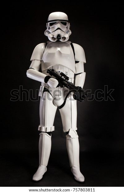 SAN BENEDETTO DEL TRONTO, ITALY. NOVEMBER 11, 2017. Studio low key portrait  of stormtrooper costume replica, with blaster E-11 gun. He is a fictional character of Star Wars saga. Black background
