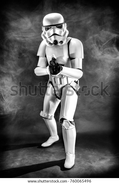 SAN BENEDETTO DEL TRONTO, ITALY. NOVEMBER 11, 2017. Studio portrait  of stormtrooper costume replica, with blaster E-11 gun. He is a fictional character of Star Wars saga. Black and white picture