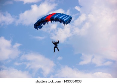 San Benedetto Tr., Italy - June 9, 2019. Aerobatics, air show. Italian carabinieri skydiver with parachute in the sky with clouds