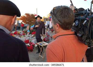 SAN BERNARDINO, CA - DECEMBER 6: Television news media crew covers visitor activities at a makeshift street-side memorial to IRC shooting victims on December 6, 2015 in San Bernardino, California.
