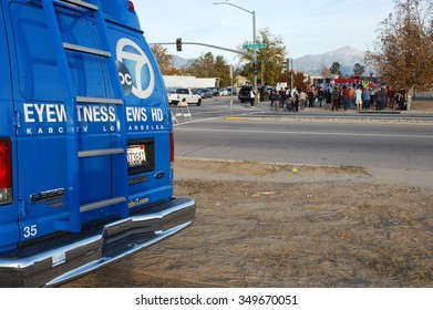 SAN BERNARDINO, CA - DECEMBER 6: Television news media crews cover visitor activities at a makeshift street-side memorial to IRC shooting victims on December 5, 2015 in San Bernardino, California.